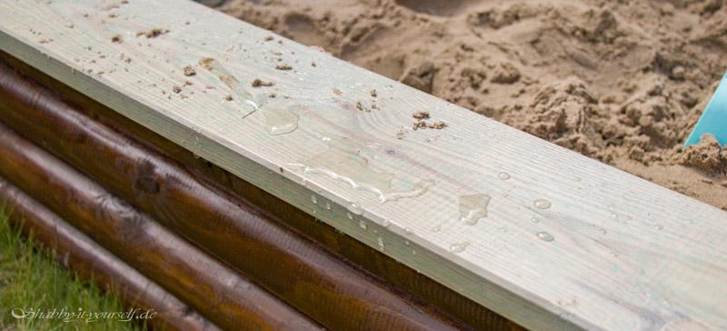 Sandkasten aus Holz Infos - Die Lasur ist wasserabweisend